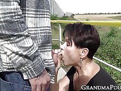 Lusty aged woman dicked down and facialized outdoors