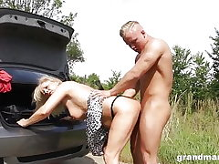 Grannie changes flat tire and bends over for some youthful cock