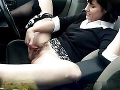 Dirty mature whore fingers her slit hole on the back seat of her car